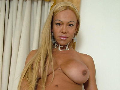 Hot shemale striping naked to play with her cock